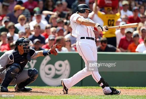 Jacoby Ellsbury of the Boston Red Sox hits a solo home run in the sixth inning as Kenji Johjima of the Seattle Mariners defends on July 5 2009 at...