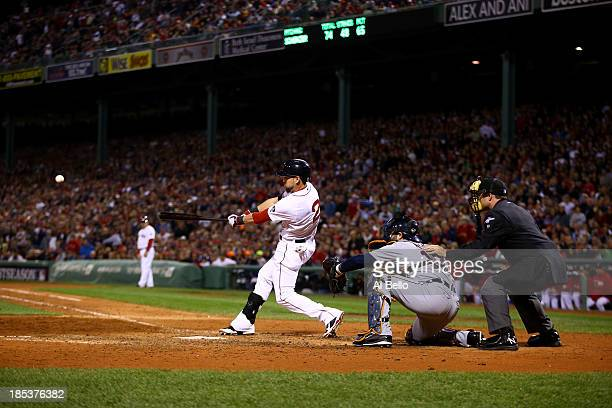 Jacoby Ellsbury of the Boston Red Sox hits single to right against Max Scherzer of the Detroit Tigers to bring home Xander Bogaerts of the Boston Red...