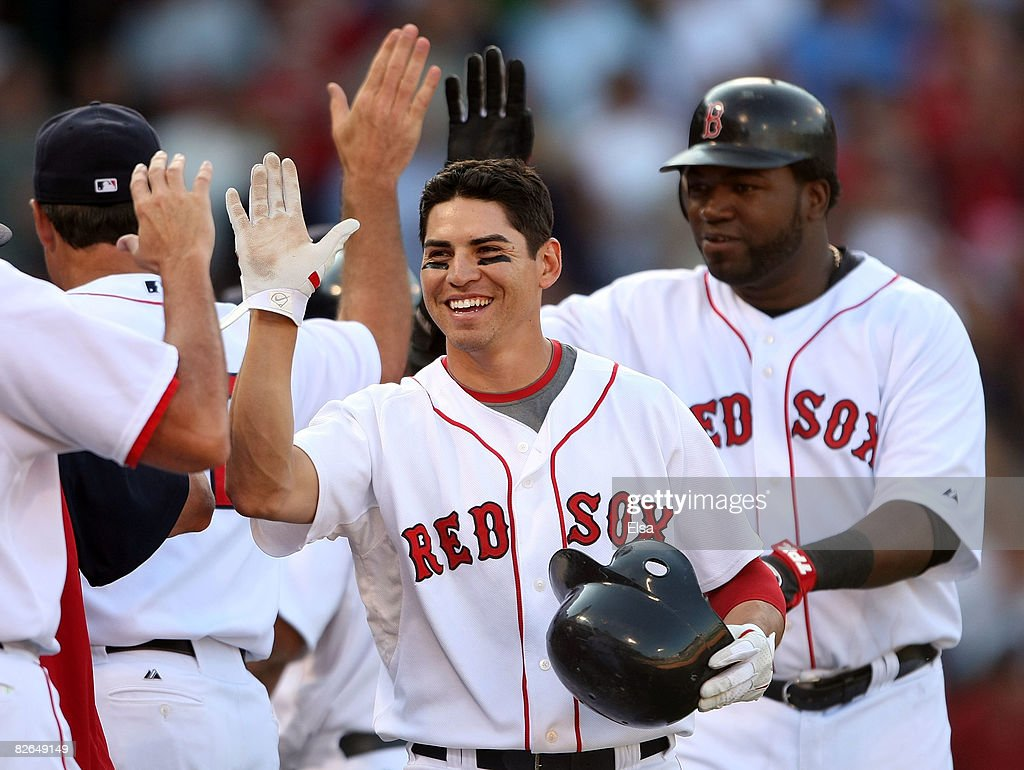 Jacoby Ellsbury #46 of the Boston Red Sox is congratulated after sending in the game winning run in the bottom of the ninth inninng against the Baltimore Orioles on September 3, 2008 at Fenway Park in Boston, Massachusetts. The Boston Red Sox defeated the Baltimore Orioles 5-4. David Ortiz #34 of the Red Sox also celebrates the win.