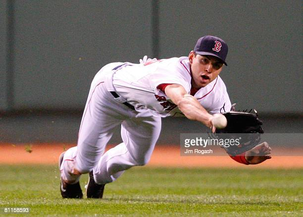 Jacoby Ellsbury of the Boston Red Sox makes a diving catch on a ball hit by Jose Guillen of the Kansas City Royals at Fenway Park on May 19, 2008 in...