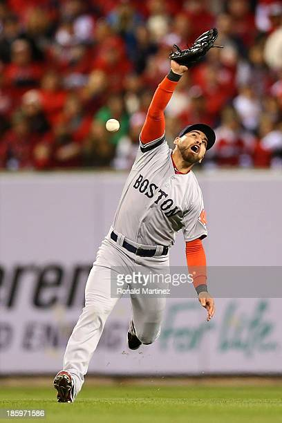 Jacoby Ellsbury of the Boston Red Sox makes an error in the third inning on a ball hit by Matt Holliday of the St Louis Cardinals during Game Three...
