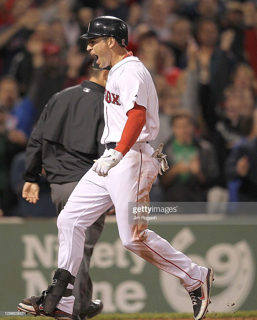 Jacoby Ellsbury #2 of the Boston Red Sox reacts after crossed home for an inside the park home against the Baltimore Orioles defends in the seventh inning during the second game of a doubleheader at Fenway Park September 19, 2011 in Boston, Massachusetts.