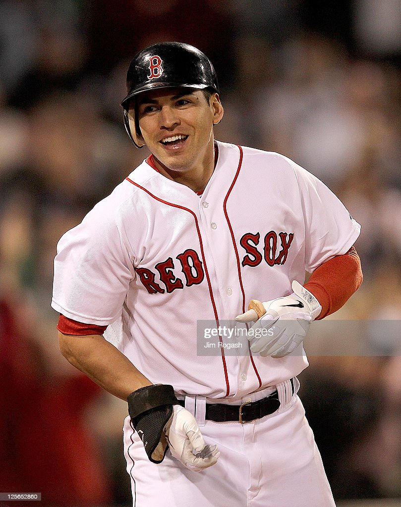 Jacoby Ellsbury #2 of the Boston Red Sox reacts after he crossed home for an inside the park home against the Baltimore Orioles defends in the seventh inning during the second game of a doubleheader at Fenway Park September 19, 2011 in Boston, Massachusetts.