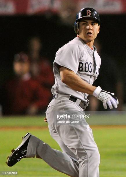 Jacoby Ellsbury of the Boston Red Sox rounds the bases after hitting a triple in the fourth inning of Game Two of the ALDS against the Los Angeles...