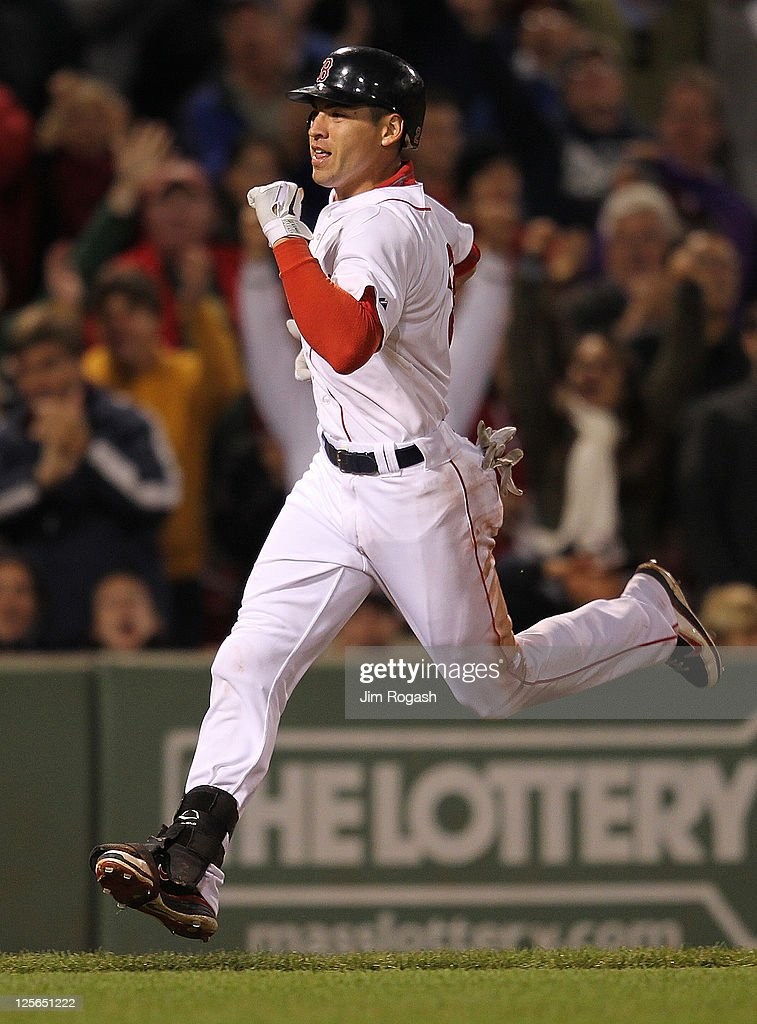 Jacoby Ellsbury #2 of the Boston Red Sox runs home for an inside the park home run against the Baltimore Orioles defends in the seventh inning during the second game of a doubleheader at Fenway Park September 19, 2011 in Boston, Massachusetts.