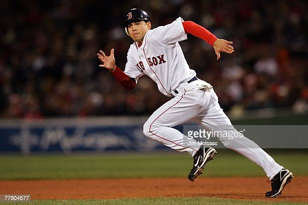 Jacoby Ellsbury of the Boston Red Sox runs to second base against the Colorado Rockies during Game Two of the 2007 Major League Baseball World Series...