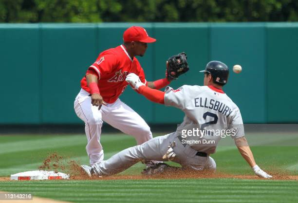 Jacoby Ellsbury of the Boston Red Sox slides into second with a leadoff double as shortstop Erick Aybar of the Los Angeles Angels of Anaheim takes...