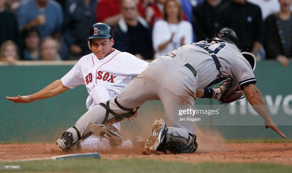 Jacoby Ellsbury #46 of the Boston Red Sox slides safely by Jorge Posada #20 of the New York Yankees on September 15, 2007 at Fenway Park in Boston, Massachusetts.