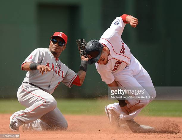 Jacoby Ellsbury of the Boston Red Sox slides underneath the tag of Erick Aybar of the Los Angeles Angels for a stolen base in the third inning on...