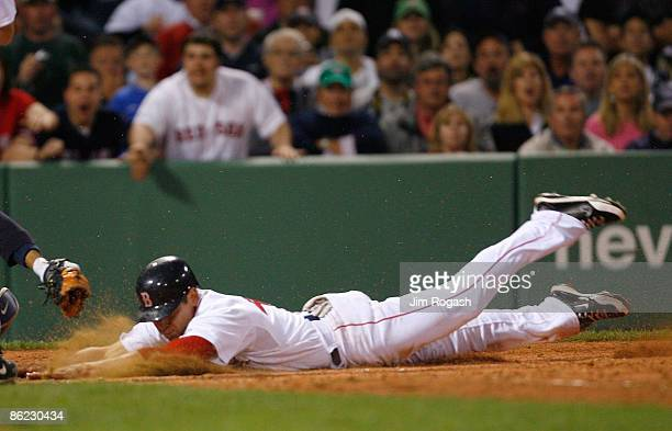 Jacoby Ellsbury of the Boston Red Sox steals home by Jorge Posada of the New York Yankees at Fenway Park April 26 2009 in Boston Massachusetts Jacoby...