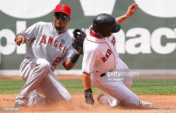 Jacoby Ellsbury of the Boston Red Sox steals second base as Erick Aybar of the Los Angeles Angels takes a late throw in the 3rd inning at Fenway Park...