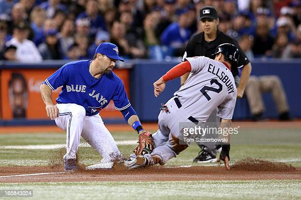 Jacoby Ellsbury of the Boston Red Sox steals third base in the first inning during MLB game action as Mark DeRosa of the Toronto Blue Jays applies...
