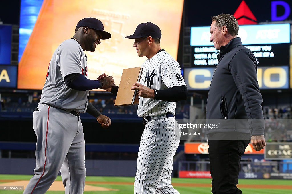 Jacoby Ellsbury #22 of the New York Yankees and David Cone presents a gift to David Ortiz #34 of the Boston Red Sox during a pregame ceremony at Yankee Stadium on September 29, 2016 in the Bronx borough of New York City. Yankees defeated the Red Sox 5-1
