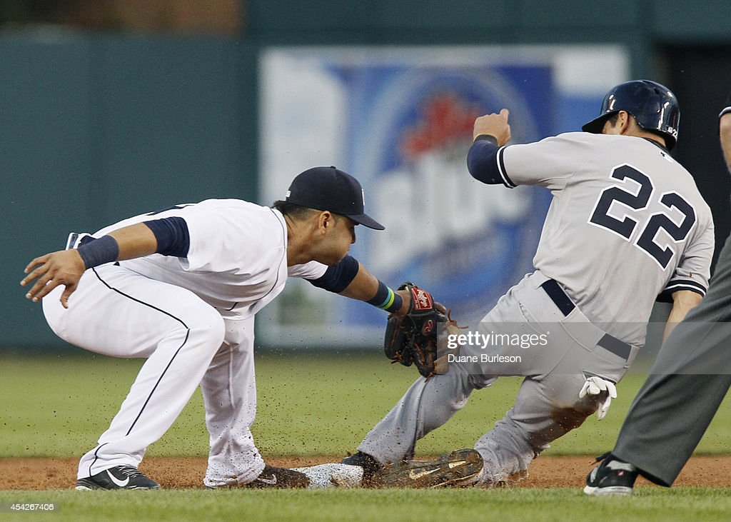 Jacoby Ellsbury #22 of the New York Yankees beats the tag from shortstop Eugenio Suarez #30 of the Detroit Tigers to steal second base during the third inning at Comerica Park on August 27, 2014 in Detroit, Michigan.