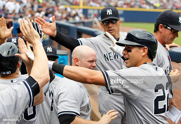 Jacoby Ellsbury of the New York Yankees celebrates after hitting a threerun homer in the second inning against the Atlanta Braves at Turner Field on...