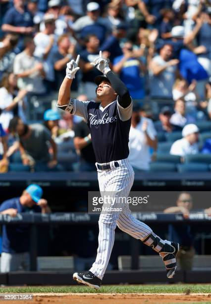 Jacoby Ellsbury of the New York Yankees celebrates his fourth inning three run home run against the Seattle Mariners at Yankee Stadium on August 26...