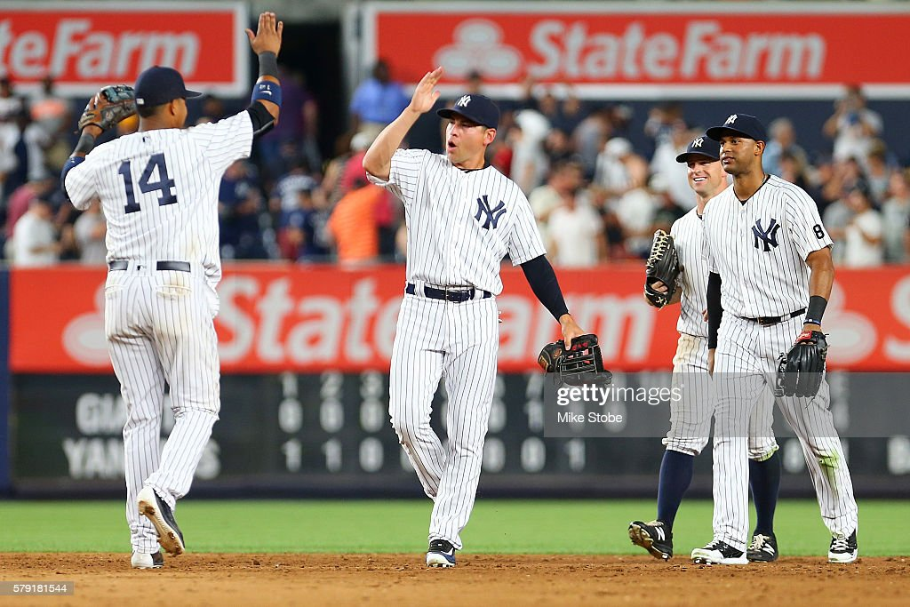 Jacoby Ellsbury #22 of the New York Yankees celebrates with Starlin Castro #14 after defeating the San Francisco Giants 3-2 at Yankee Stadium on July 22, 2016 in the Bronx borough of New York City.