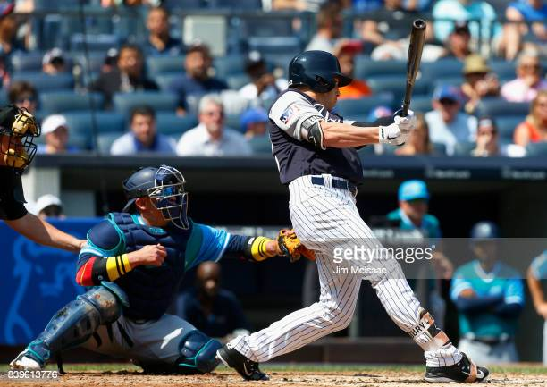 Jacoby Ellsbury of the New York Yankees follows through on a second inning RBI single against the Seattle Mariners at Yankee Stadium on August 26...