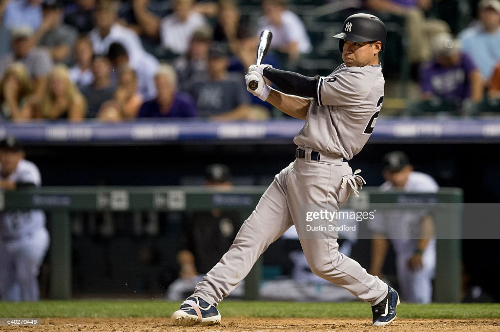 Jacoby Ellsbury #22 of the New York Yankees hits a 2-RBI single against the Colorado Rockies in the eighth inning during a regular season interleague game at Coors Field on June 14, 2016 in Denver, Colorado.