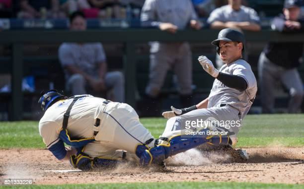 Jacoby Ellsbury of the New York Yankees is tagged out at home plate by catcher Carlos Ruiz of the Seattle Mariners on a double hit by Chase Headley...