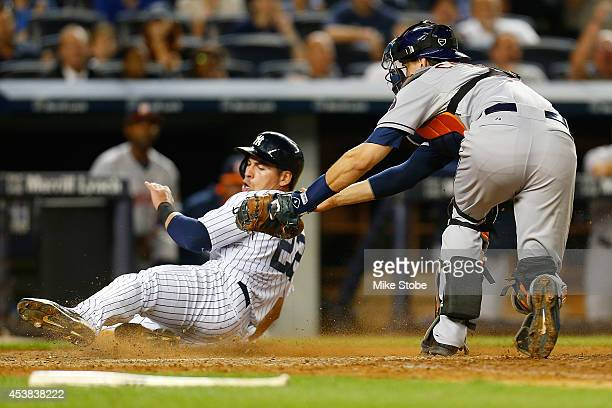Jacoby Ellsbury of the New York Yankees is thrown out at homeplete in the eighth inning against the Houston Astros at Yankee Stadium on August 19...