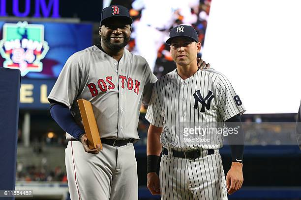 Jacoby Ellsbury of the New York Yankees presents a a gift to David Ortiz of the Boston Red Sox during a pregame ceremony at Yankee Stadium on...