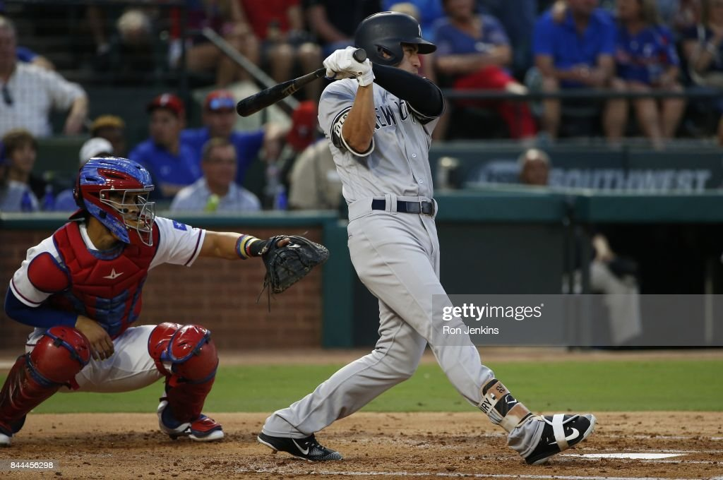 Jacoby Ellsbury #22 of the New York Yankees singles and drives in a run against the Texas Rangers during the second inning at Globe Life Park in Arlington on September 8, 2017 in Arlington, Texas.