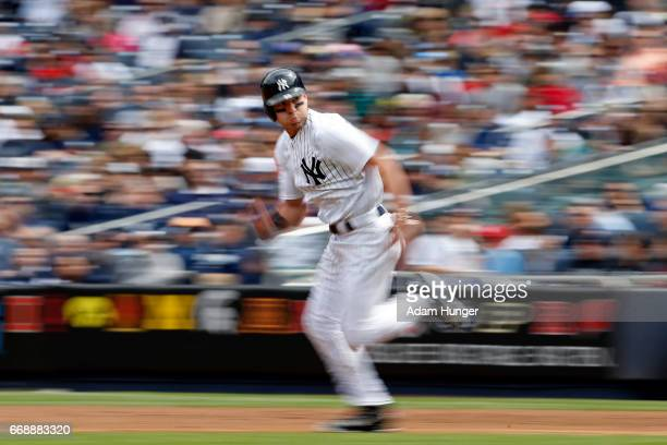 Jacoby Ellsbury of the New York Yankees steals second base during the third inning against the St Louis Cardinals at Yankee Stadium on April 15 2017...
