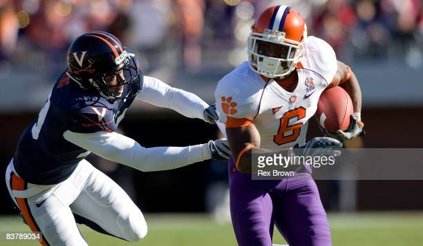 Jacoby Ford of the Clemson Tigers picks up a first down as he is tackled by Ras-I Dowling of the Virginia Cavaliers at Scott Stadium on November 22,...