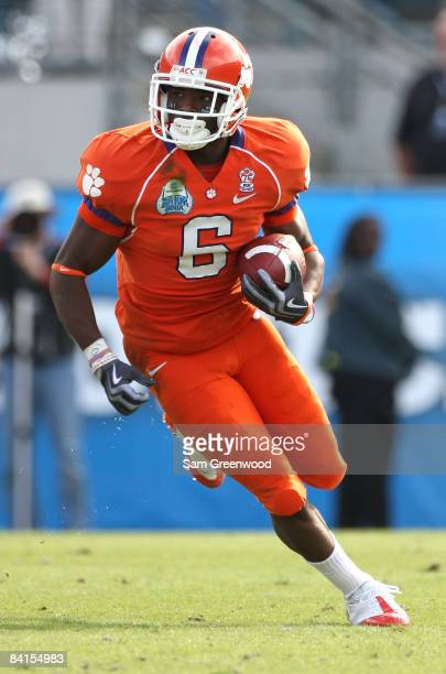 Jacoby Ford of the Clemson Tigers runs for yardage after a reception during the Konica Minolta Gator Bowl against the Nebraska Cornhuskers at...