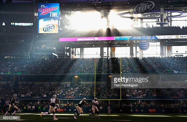 Jacoby Ford of the Oakland Raiders carries the ball against the Dallas Cowboys during a Thanksgiving Day game at ATT Stadium on November 28 2013 in...