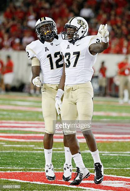 Jacoby Glenn and Brandon Alexander of the UCF Knights celebrate after Alexander made an interception during the second half against the Houston...