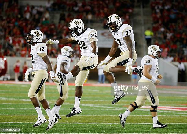 Jacoby Glenn Jared Henry and Brandon Alexander of the UCF Knights celebrate after Alexander made an interception during the second half against the...
