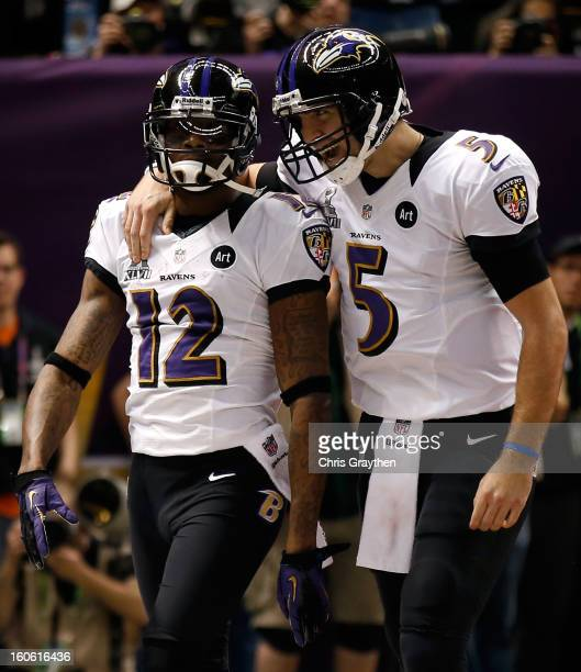 Jacoby Jones and Joe Flacco of the Baltimore Ravens celebrate after a touchdown in the second quarter against the San Francisco 49ers during Super...