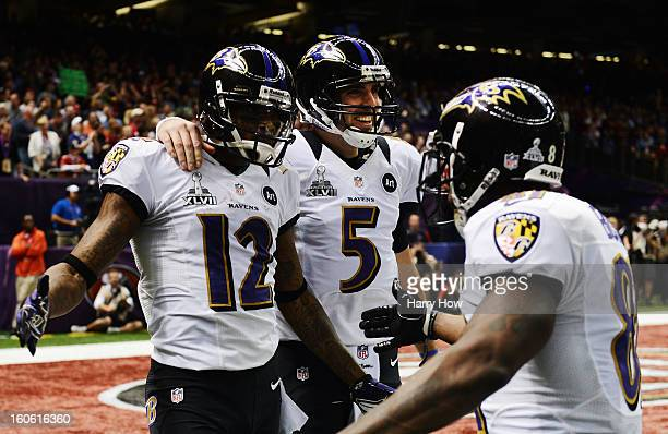 Jacoby Jones, Joe Flacco and Anquan Boldin of the Baltimore Ravens celebrate after Jones caught a 56-yard touchdown pass from Flacco in the second...