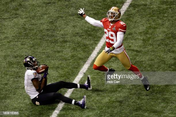 Jacoby Jones of the Baltimore Ravens catches a 56yard touchdown reception in the second quarter against Chris Culliver of the San Francisco 49ers...