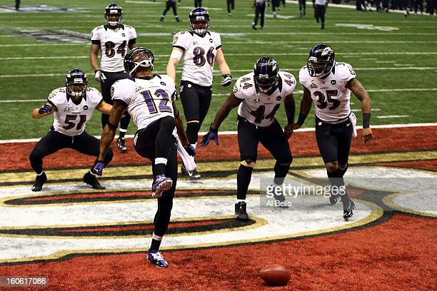 Jacoby Jones of the Baltimore Ravens celebrates his record 108yard kickoff return for a touchdown with his teammates in the third quarter against the...