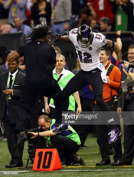 Jacoby Jones of the Baltimore Ravens celebrates on the sideline following his 56-yard touchdown pass in the second quarter against the San Francisco...