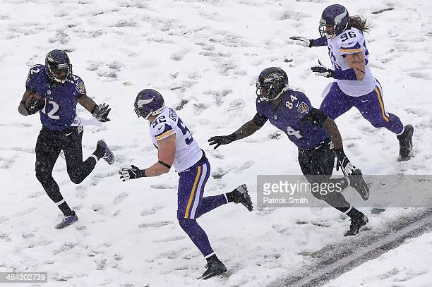 Jacoby Jones of the Baltimore Ravens returns a punt in the second quarter against the Minnesota Vikings at M&T Bank Stadium on December 8, 2013 in...
