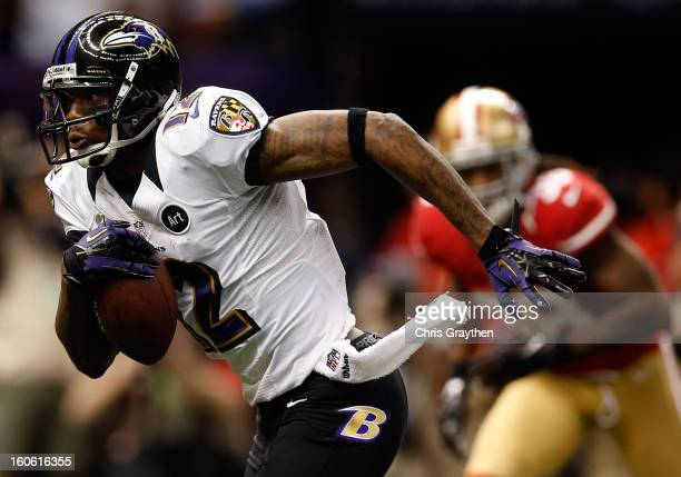 Jacoby Jones of the Baltimore Ravens runs with the ball for a 56 yard touchdown against the San Francisco 49ers in the second quarter during Super...