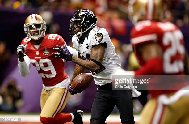 Jacoby Jones of the Baltimore Ravens runs with the ball for a 56 yard touchdown past Chris Culliver of the San Francisco 49ers in the second quarter...