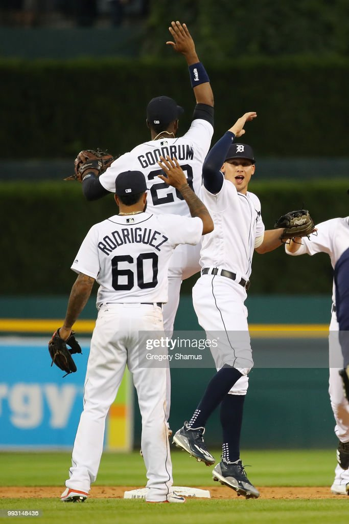 JaCoby Jones #21 of the Detroit Tigers celebrates a 3-1 win over the Texas Rangers with Niko Goodrum #28 and Ronny Rodriguez #60 at Comerica Park on July 6, 2018 in Detroit, Michigan.