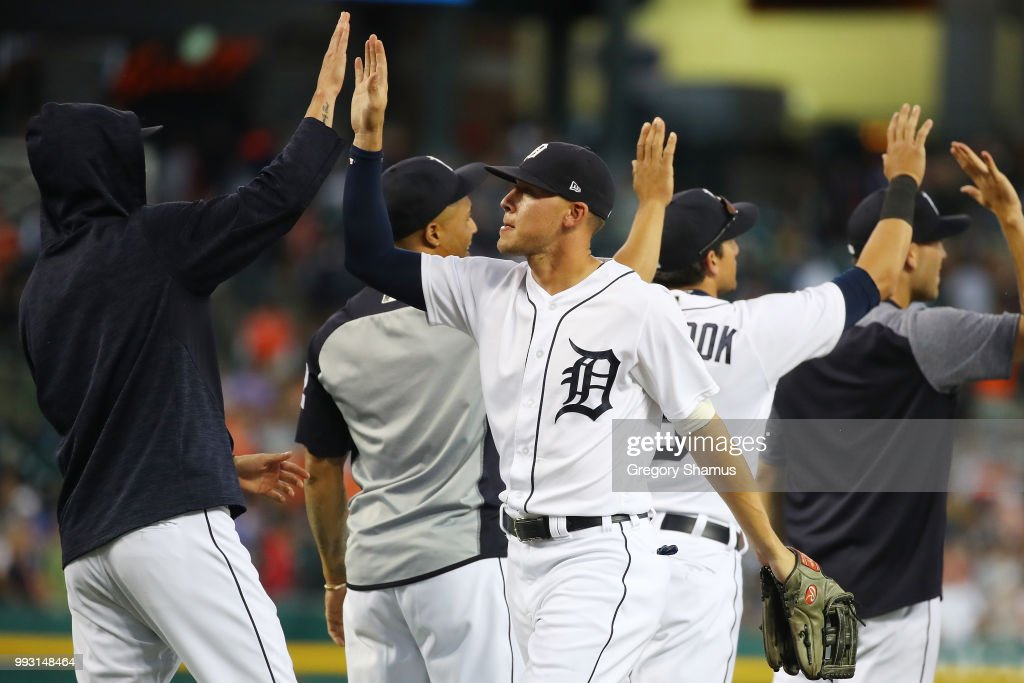 JaCoby Jones #21 of the Detroit Tigers celebrates a 3-1 win over the Texas Rangers with teammates at Comerica Park on July 6, 2018 in Detroit, Michigan.