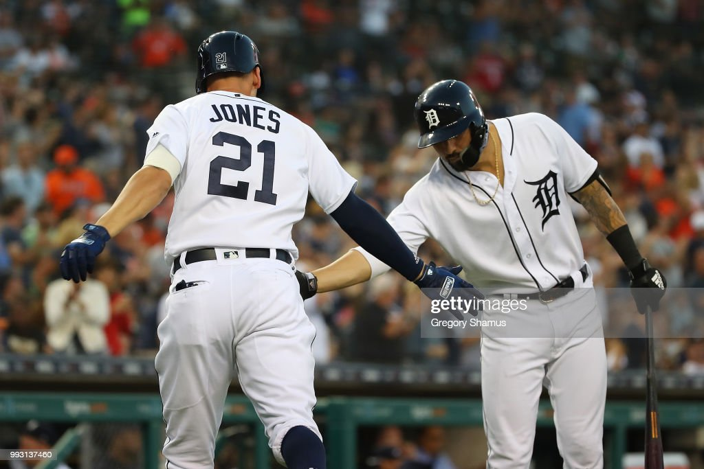 JaCoby Jones #21 of the Detroit Tigers celebrates his eighth inning solo home run with Nicholas Castellanos #9 while playing the Texas Rangers at Comerica Park on July 6, 2018 in Detroit, Michigan. Detroit won the game 3-1.