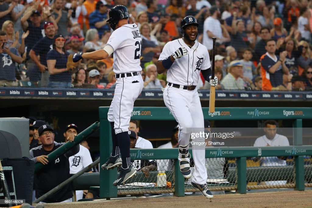 JaCoby Jones #21 of the Detroit Tigers celebrates his eighth inning solo home run with Niko Goodrum #28 while playing the Texas Rangers at Comerica Park on July 6, 2018 in Detroit, Michigan. Detroit won the game 3-1.