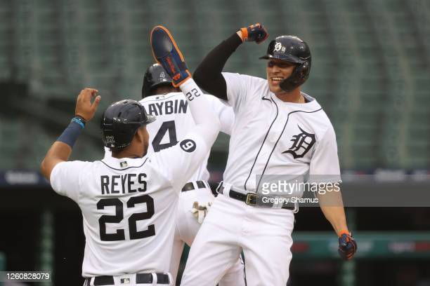 JaCoby Jones of the Detroit Tigers celebrates his second inning three run home run with Victor Reyes and Cameron Maybin while playing the Kansas City...