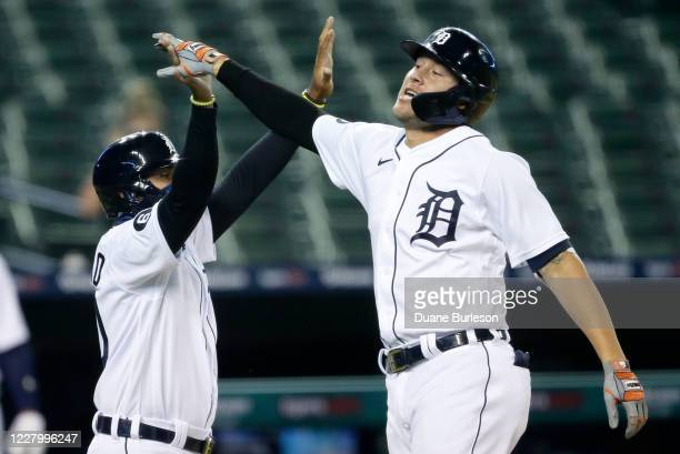 JaCoby Jones of the Detroit Tigers celebrates with Harold Castro of the Detroit Tigers after hitting an inside-the-park home run against the Chicago...