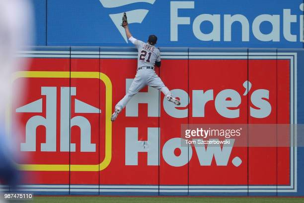 JaCoby Jones of the Detroit Tigers climbs the left field wall but cannot get to a tworun home run hit by Justin Smoak of the Toronto Blue Jays in the...