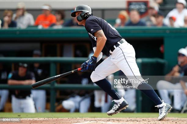 JaCoby Jones of the Detroit Tigers hits a double during the fourth inning of the Miami Marlins of the Spring Training game against the Detroit Tigers...