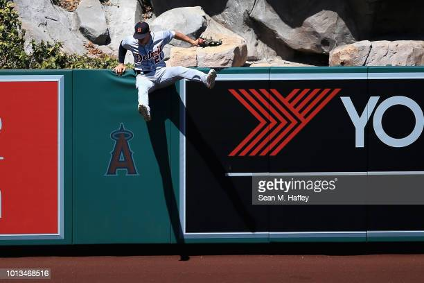 JaCoby Jones of the Detroit Tigers hits the wall trying to catch a solo homerun hit by Albert Pujols of the Los Angeles Angels of Anaheim during the...